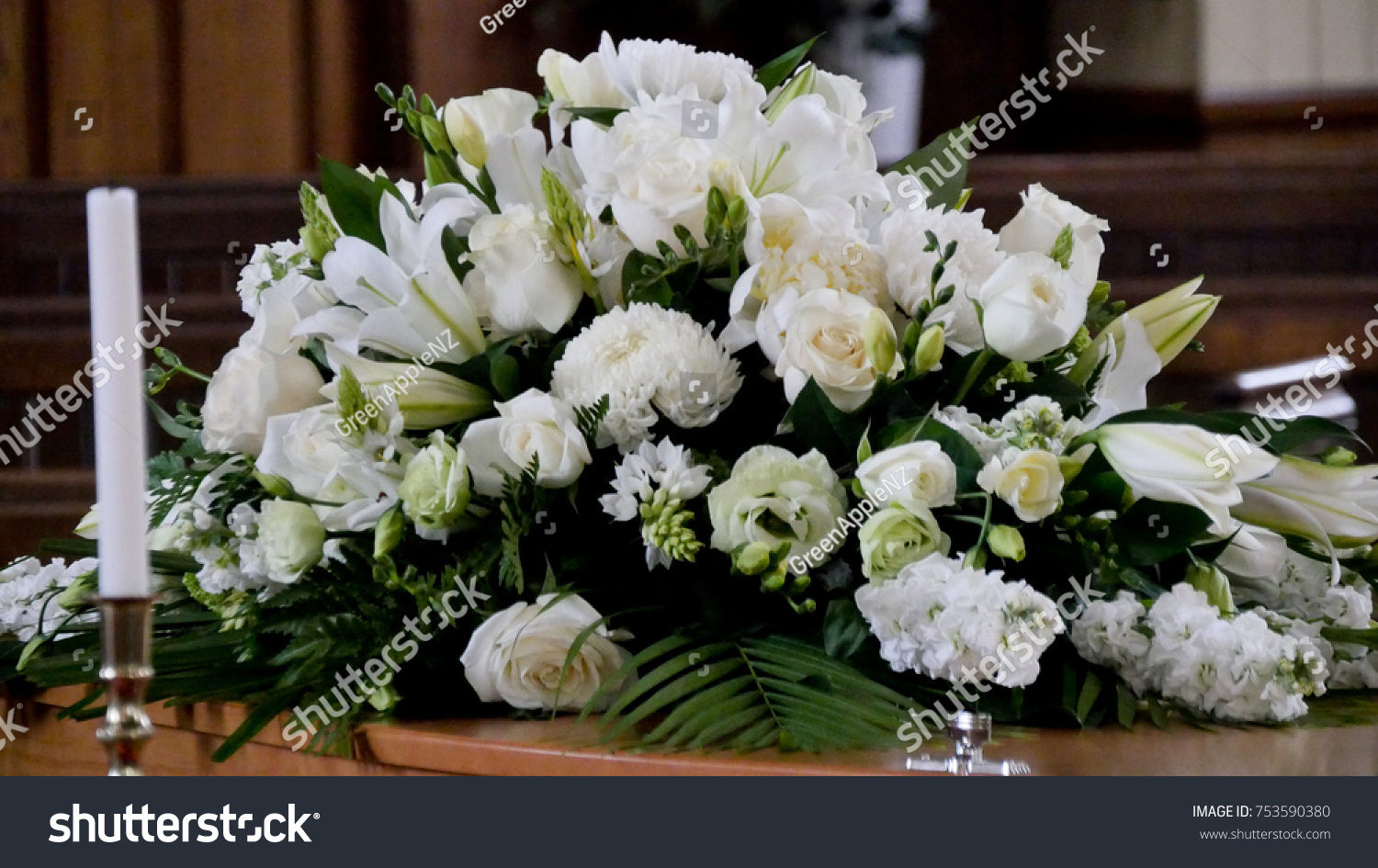 stock-photo-shot-of-flower-candle-used-for-a-funeral-753590380